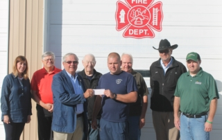 The West Central Iowa Regional Board of REALTORS® and the REALTOR® Foundation of Iowa recently made a $700 donation to the Audubon Fire Department. Wanting to give back to the communities in which they work and reside, the local board and the REALTOR® Foundation of Iowa felt that area fire departments could use the funds to help with the maintenance & purchase of fire equipment. The REALTOR® Foundation of Iowa offers financial support to Iowans in need and organizations working to improve the quality of life for Iowans. Those pictured left to right: REALTOR® Genelle Deist, REALTOR® Chris Anderson, REALTOR® Lyle Hansen Jr, Audubon Fire Department Secretary/Treasurer Cliff Petersen, Audubon Fire Chief Tyler Thygesen, REALTOR® Dennis Olesen, REALTOR® and Audubon Fire Department member Bruce Christensen, and Audubon Assistant Fire Chief Andy Griffith.
