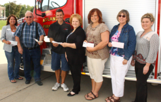 A donation of $700 was made to the Atlantic Fire Department by the West Central Iowa Regional Board of REALTORS® and the REALTOR® Foundation of Iowa. The fire department was chosen as the recipient because it serves the entire community. It will be used for some new equipment and programs.